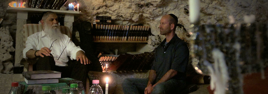 Steven studying the Zoh with Rav Avraham Sutton in a cave in Jerusalem
